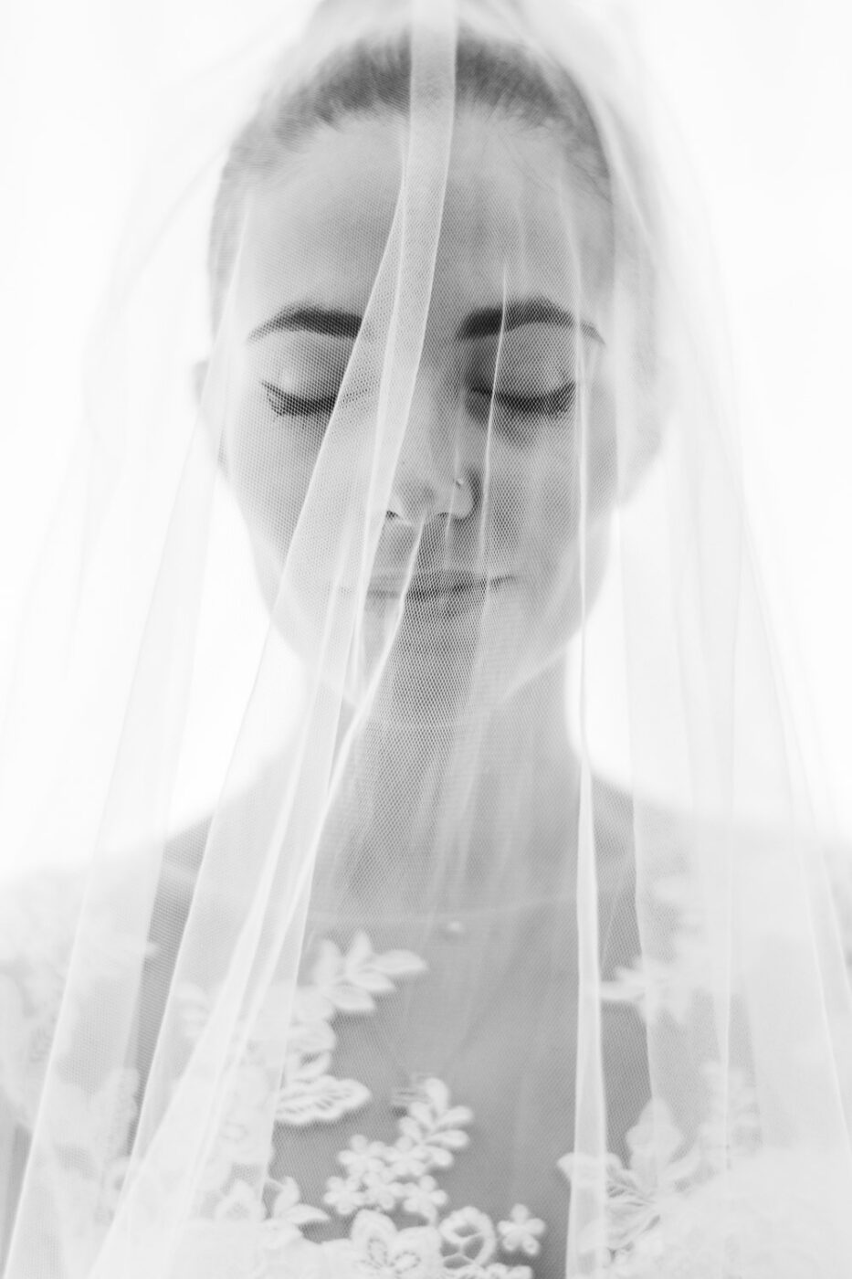 Black & White portrait of a bride under her veil with a thoughtful expression and eyes closed at Brix 2.0 in Brixen Italy by Luxury Wedding Photographer Francesco Bognin