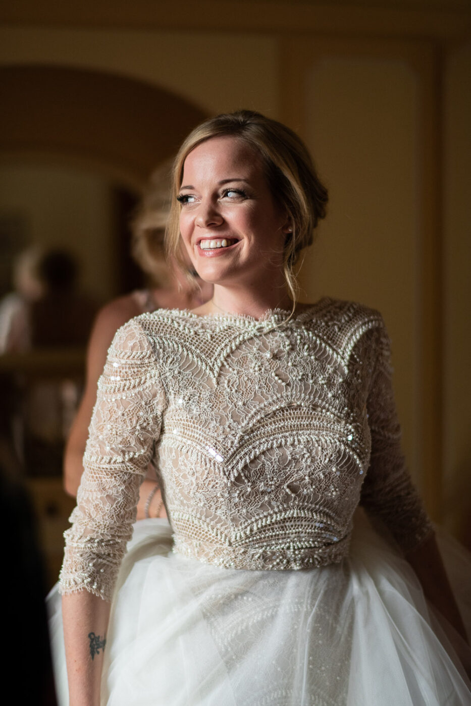 Stunning and smiling blonde bride in her wedding gown at Villa Pizzo Lake Como Italy by Luxury wedding photographer in Italy Francesco Bognin