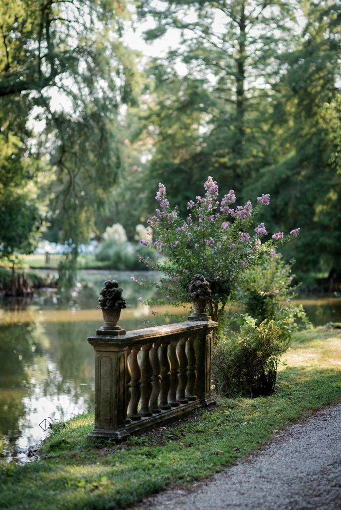 A bit of railing in a gorgeous garden villa from the middle ages in Italy, set against a lake and surrounded by trees and flowers, shot by luxury wedding photographer Francesco Bognin