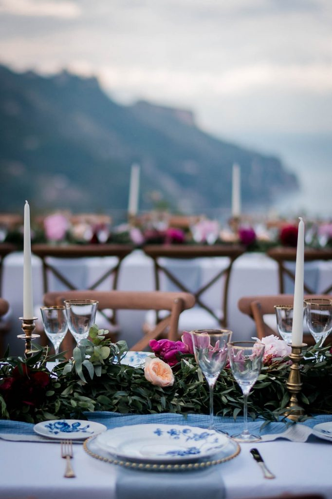 Lovely fuscia and pink flowers decorate a table of blue and white cloisonné for a pre-wedding tea ceremony in the amalfi coast at Belmond Hotel Caruso, planned by Brenda Babcock and shot by luxury wedding photographer Francesco Bognin